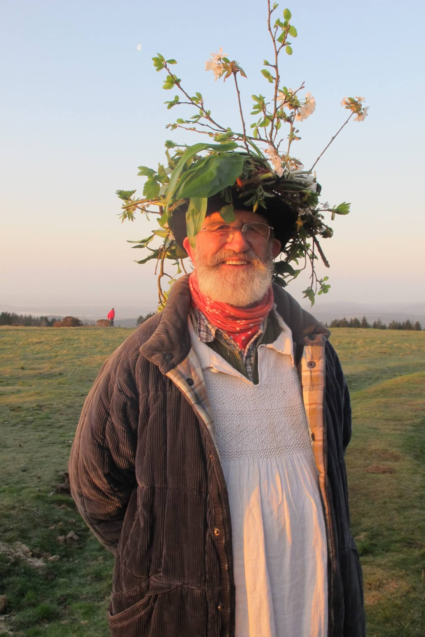 A May Day reveller welcomes in the warmer months
